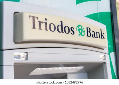 MADRID, SPAIN - APRIL 27, 2019. Triodos bank logo on Triodos cash machine. Triodos Bank is a bank based in the Netherlands