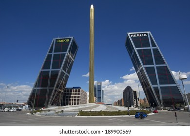 Madrid, Spain - April 6, 2014: La Puerta de Europa known as Torres KIO (KIO Towers) at Paseo de la Castellana. The leaning towers owned by Bankia and Realia are designed by Philip Johnson, John Burgee