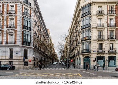Madrid, Spain - April 7, 2018:  Castellana Avenue in Madrid in Salamanca District a cloudy day