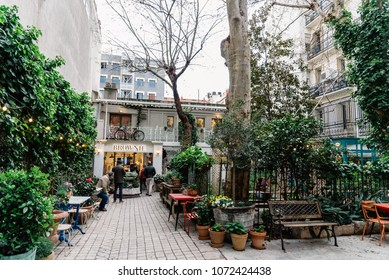 Madrid, Spain - April 7, 2018:  Courtyard with luxury fashion shops near Serrano Street in Madrid in Salamanca District a cloudy day