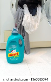 MADRID, SPAIN - APRIL 9, 2019: NORIT detergent bottle next to washing machine. ILLUSTRATIVE EDITORIAL.