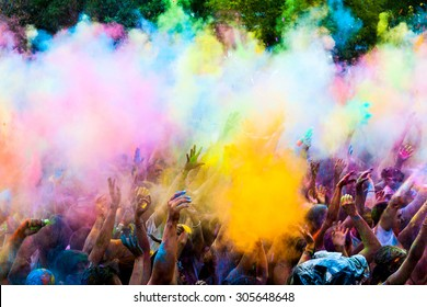MADRID SPAIN -AUG 8: People celebrated Monsoon Holi Festival of Colors on August 8, 2015 in Madrid, Spain. People dancing and celebrating during the color throw.