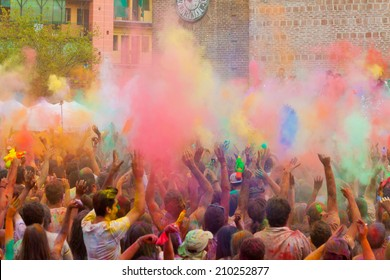 MADRID SPAIN -AUG 9: People celebrated Monsoon Holi Festival of Colors on August 9, 2014 in Madrid, Spain. People dancing and celebrating during the color throw.