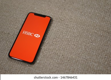 Madrid, Spain - August 01, 2019; HSBC Iphone XS Application on a Brown Rug