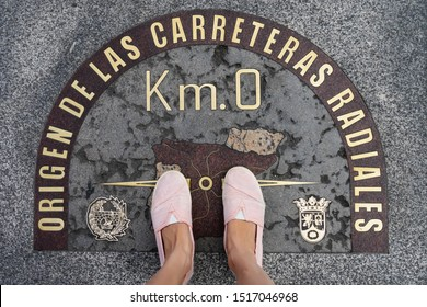 Madrid, Spain - August 1, 2018: Kilometer Zero located in Puerta del Sol, showing the geographical center of Spain. Feet staying in the middle.