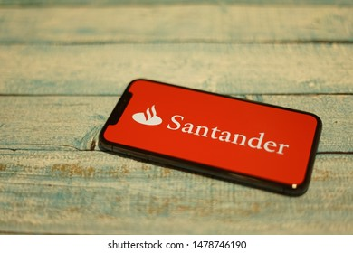 Madrid, Spain - August 14, 2019; Santander Mobile Banking Iphone X Application on a Rustic Pallet Table Background