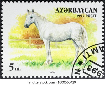 MADRID, SPAIN - AUGUST 21, 2020. Vintage stamp printed in Azerbaijan shows Orlov Trotter, a horse breed with a hereditary fast trot, the most famous Russian horse