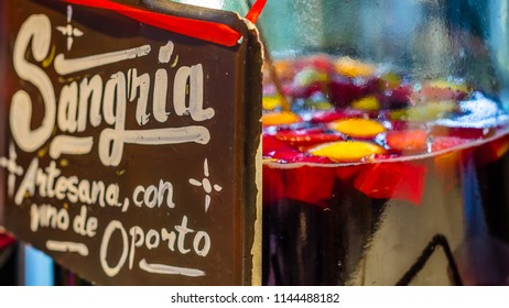 """MADRID, SPAIN - AUGUST 27, 2017:  Artisan port wine sangria served at a market stand inside the historical """"Mercado de San Miguel"""" (Market of San Miguel), popular among tourists, in Madrid, Spain"""