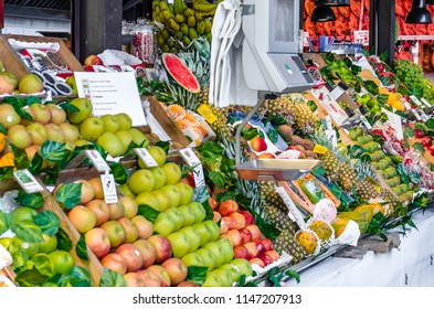 """MADRID, SPAIN - AUGUST 27, 2017:  Colorful fresh fruit stall inside the historical """"Mercado de San Miguel"""" (Market of San Miguel), popular among tourists, located in the center of Madrid, Spain"""