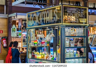 """MADRID, SPAIN - AUGUST 27, 2017:  Colorful drinks and cocktails stand in the historical """"Mercado de San Miguel"""" (Market of San Miguel), popular among tourists, located in the center of Madrid, Spain"""