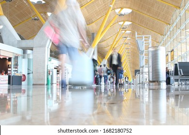 Madrid, Spain; August 27, 2019: Madrid airport t4 terminal, blurred people walking in the interior of the terminal