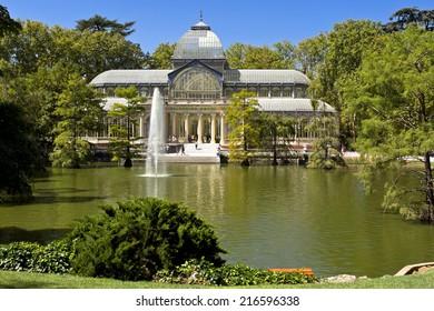 MADRID, SPAIN - AUGUST 28: Crystal Palace at El Retiro Park in Madrid, Spain on August 28, 2014. Crystal Palace is famous landmark of El Retiro park