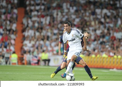 MADRID, SPAIN - AUGUST 29: Angel Di Maria running with the ball during the Supercopa, Real Madrid vs FC Barcelona, on August 29, 2012 at the Santiago Bernabeu Stadium.