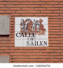 MADRID, SPAIN - AUGUST 31, 2018: Street nameplate, made of glazed tiles with name of the street and some stylized painting in typical Spanish artistic style.