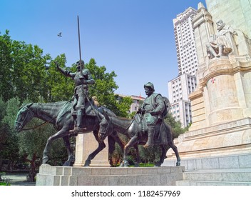MADRID, SPAIN - AUGUST 31, 2018: Stone monument to Spanish writer Miguel de Cervantes Saavedra with two bronze sculptures of Don Quixote and Sancho Panza, located at Plaza de Espana of Madrid city.