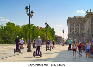 MADRID, SPAIN - AUGUST 31, 2018: Excursions on Calle de Bailen street along the Royal Palace of Madrid (Spanish: Palacio Real de Madrid).