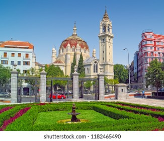 MADRID, SPAIN - AUGUST 31, 2018: A view from Retiro Park onto Church of San Manuel y San Benito. Built in 1910, it is one of the best examples of Neo-Byzantine architecture in Madrid.