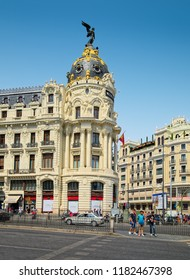 MADRID, SPAIN - AUGUST 31, 2018: Edificio Metropolis (Metropolis Building) with it's luxury decor - one of the most iconic landmarks on city streets.