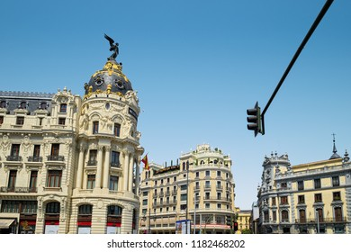MADRID, SPAIN - AUGUST 31, 2018: Edificio Metropolis (Metropolis Building) and other luxury houses at corner of Calle de Alcala and Gran Vía streets of city.