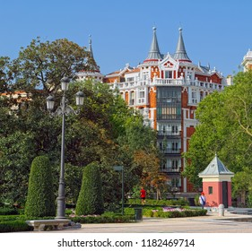 MADRID, SPAIN - AUGUST 31, 2018: Picturesque residential building in mixed style of medieval architecture and post modernism, built in 1887 at Calle de Alfonso XII street of Madrid.