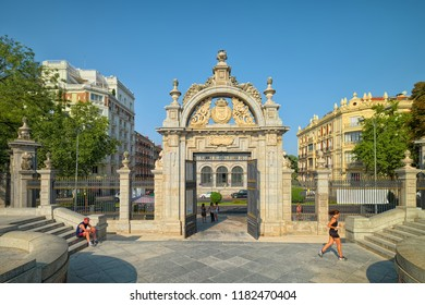 MADRID, SPAIN - AUGUST 31, 2018: One of entrances of Retiro Park - Puerta Felipe IV (Gate of Philip IV), it was built in 1680 as a triumphal arch for Queen María Luisa de Orleans.