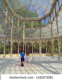 MADRID, SPAIN - AUGUST 31, 2018: A visitors inside of Palacio de Cristal (Crystal Palace), it's built in 1887 in Retiro Park as art venue and exibitions