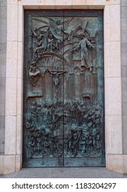 MADRID, SPAIN - AUGUST 31, 2018: Sculptural bronze doors of Almudena Cathedral (full name: Catedral de Santa Maria la Real de la Almudena), artwork created by Luis Antonio Sanguino in 2000.