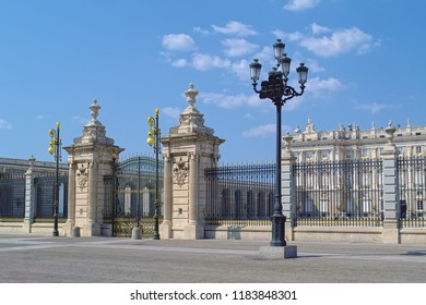 MADRID, SPAIN - AUGUST 31, 2018: Plaza de la Armeria square with luxury gate and partial view to Royal Palace of Madrid (Spanish: Palacio Real de Madrid).
