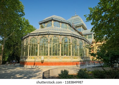 MADRID, SPAIN - AUGUST 31, 2018: Side view of Palacio de Cristal (Crystal Palace), built in 1887 in Retiro Park and now used for art exhibits.