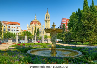 MADRID, SPAIN - AUGUST 31, 2018: Fontain in Retiro Park on a backround of Church of San Manuel y San Benito.
