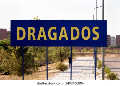 Madrid, Spain - AUGUST 31, 2019: Dragados logo on Dragados advertisement. Dragados is a Spanish company dedicated to civil and engineering construction won by ACS group