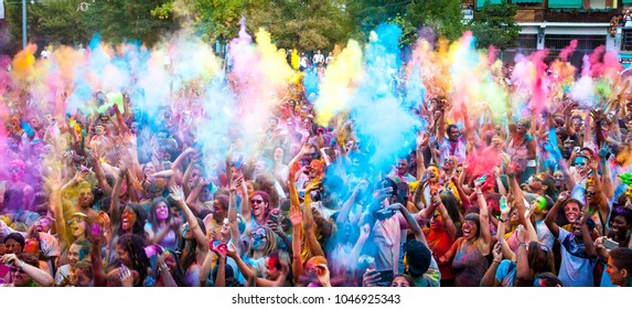 Madrid, Spain - August 5 2017: : People celebrated Monsoon Holi Festival of Colors on August 5, 2017 in Madrid, Spain. People dancing and celebrating during the color throw.