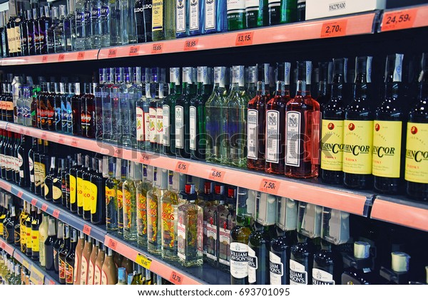 MADRID, SPAIN - AUGUST 5, 2017: Shelf full of alcohol bottles of different types in a supermarket
