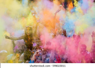 MADRID, SPAIN - AUGUST 8, 2015. People covered with colored powder during the celebration of the Indian Holi festival in the streets of Madrid
