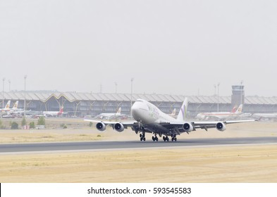 MADRID, SPAIN - AUGUST 8th 2015: Plane Boeing 747, of Wamos Air airline, is taking off from Madrid - Barajas, Adolfo Suarez airport, on August 8th 2015. Cloudy day of summer.