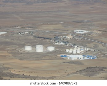 MADRID, SPAIN - CIRCA OCTOBER 2017: oil or petroleum tanks in the desert, aerial view from aircraft near Madrid-Barajas Adolfo Suarez Airport