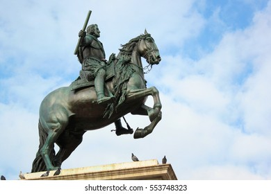 MADRID, SPAIN - DECEMBER 13, 2016: Equestrian statue of Philip IV by Pietro Tacca in front of Royal Palace of Madrid on the Plaza de Oriente in Madrid, Spain.