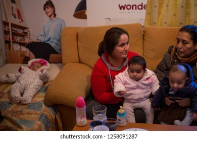 MADRID, SPAIN - DECEMBER 14, 2018 Several neighbors and activists with their children accompany the family in the house moments before the eviction is postponed.