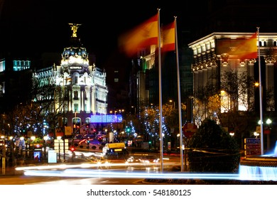 MADRID, SPAIN - DECEMBER 17, 2016: Rays of traffic lights at night on Gran via street, main shopping street in Madrid. Spain, Europe.