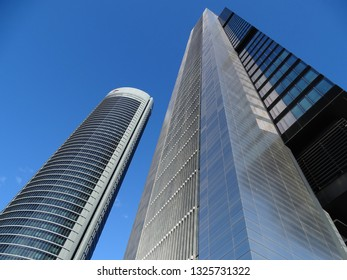 Madrid, Spain - December 18, 2016: Four modern skyscrapers in the Cuatro Torres Business Area. Crystal, Space, Pwc and CEPSA Towers are the tallest buldings in the country.