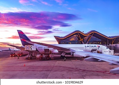 MADRID, SPAIN, DECEMBER - 2017 - Sunrise scene passenger plane parked at Barajas airport, Madrid, Spain