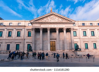 Madrid, Spain. December 2017:Group of tourist taking pictures in front of the Congreso de los diputados or Spanish Parliament
