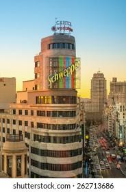 MADRID, SPAIN - DECEMBER 21: Aerial view of Capitol Building and Gran Via street in Madrid in sunset, Spain. Europe.