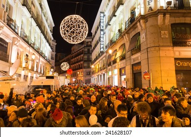 MADRID, SPAIN - DECEMBER 31, 2014: The famous Puerta del Sol crowded with tourists on December 31 in Madrid. Puerta del Sol traditionally is the centre of New Year celebrations each year in Madrid.