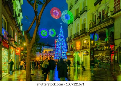 MADRID, SPAIN - DECEMBER 31, 2017: Scene of Puerta del Sol square, with a Christmas tree, locals and visitors, in Madrid, Spain
