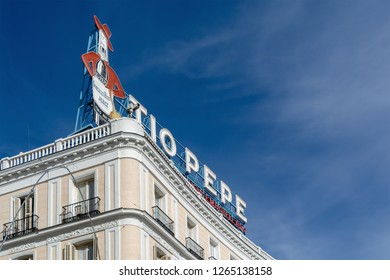 """MADRID, SPAIN - December 8, 2018: The famous """"Tio Pepe"""" sign on a buidling in Puerta del Sol square in Madrid, Spain."""