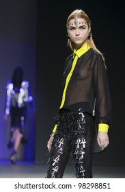 MADRID, SPAIN -  FEBRUARY 04: A model walks on the Maria Escote catwalk during the Mercedes-Benz Fashion Week Madrid runway on February 04, 2012 in Madrid, Spain.