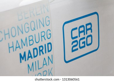 MADRID, SPAIN - FEBRUARY 10, 2019. Car2Go logo on Car2Go car. Car2Go is a car sharing company of Daimler