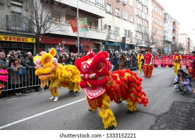 Madrid, Spain - February 10, 2019: Colorful dragon dance in the Chinese New Year parade, year of the pig.