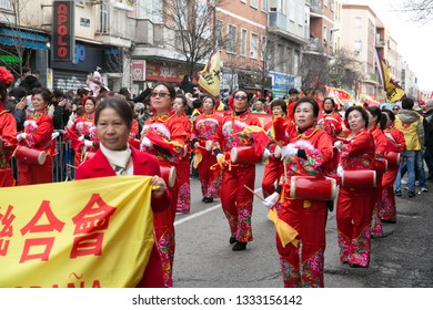 Madrid, Spain - February 10, 2019: Leading authorities with banner in celebration of Chinese new year parade